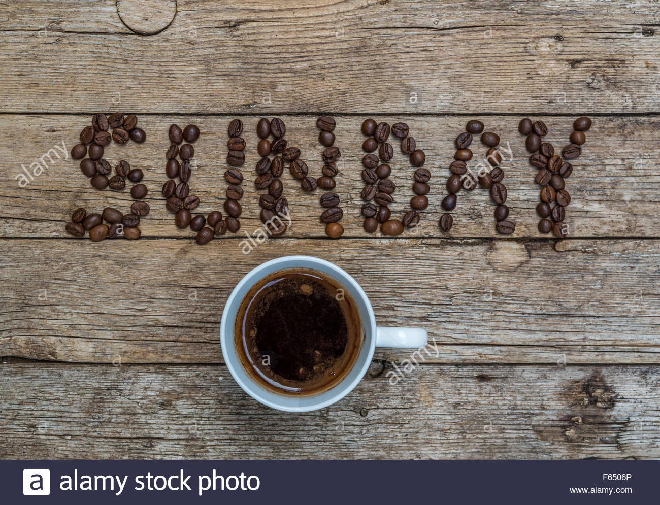 Cup of coffee on wooden background and SUNDAY coffee beans Stock ... #sundayCoffee